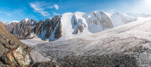 Wide Panorama Of The Big Glacier, High In The Mountains, Covered By Snow And Ice.
