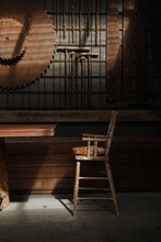Old Vintage Wooden Chair With Industrial Timber Mill Background