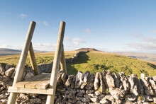 Stile On Middlesmoor Pasture Looking Back At Old Cote Moor Top Above Starbotton In The Yorkshire Dales, UK.