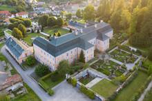Representative Pink Rococo Nove Hrady Castle From 1777, French Garden, Village Near Litomysl, Pardubice Region, Czech Republic. Aerial View, Summer Time.