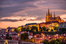 Cityscape Of Prague With The Famous Castle During Sunset.