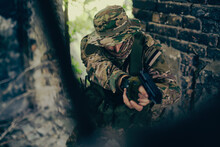 Airsoft Player Aiming With A Replica Pistol