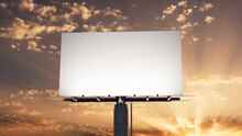 Marketing Billboard. Empty Large Format Sign Against A Sunset Evening Sky. Mockup Template.