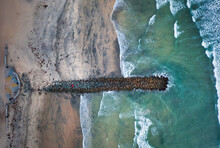 Overhead Top-down Drone View Of Jetty With Waves Breaking