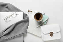 Female Shirt, Stylish Accessories, Laptop And Cup Of Coffee On Light Background