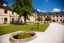 Kuks, East Bohemia, Czech Republic, 10 July 2021: Baroque Castle And Hospital Kuks, Courtyard With Garden And Antique Facade, Beautiful Complex With Chateau, Holy Trinity Church At Sunny Summer Day.