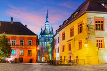 Sighisoara In Transylvania, Romania. The Medieval Town At Sunset. Birth Place Of Vlad The Impaler(Dracula).