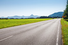 Empty Asphalt Road And Mountains On Background