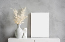 Blank Canvas Frame Mockup On Gray Wall. White Living Room Design. View Of Modern Scandinavian Style Interior With Artwork Mock Up On Wall. Home Staging And Minimalism Concept
