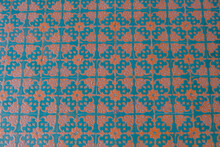 Blue And Orange Pattern On Floor Tiles Close-up. Top View. Interior Design. Tiles Background