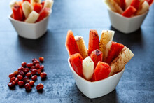 Fruit Sticks With Chili Spice. Fresh Raw Sweet Cut Fruit With Spicy Chile And Cocoa Condiment Powder. Summer Snack.