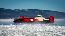 Coast Guard Hovercraft Breaking Ice Near A Small Community In  Eastern Quebec, Canada.