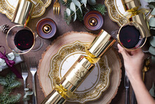 Christmas, A Table Setting, Overhead View, Wine And Candles, Plates And Cutlery And A Cracker