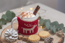 Christmas, A Mug Of Hot Chocolate Or Eggnog With A Knitted Wraparound Cosy And Mince Pies.