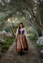 Witch With Broomstick In Forest