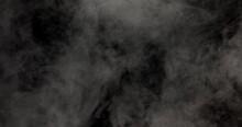 White Smoke Slowly Moving On A Black Background.