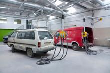 Two Vans In A Large Repair Workshop For Repair And Respraying