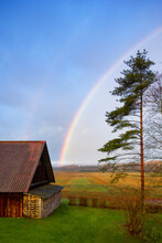 Rural Scene, A Rainbow In The Sky Over A Barn, After Rain.