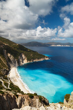Aerial View At Myrtos Beach And Fantastic Turquoise And Blue Ionian Sea Water. Greek Islands. Top View, Summer Scenery Of Famous And Extremely Popular Travel Destination In Cephalonia, Greece, Europe.