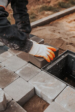 The Technology Of Laying Natural Stone From Paving Slabs - The Work Of A Bricklayer To Install The Floor Outside