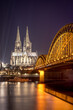 Beautiful view of Cologne Cathedral with Hohenzollern Bridge at night