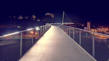Illuminated Pedestrian Bridge At Night