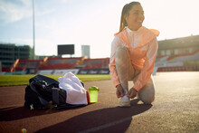 A Young Girl Is Ready For An Athletic Training At The Stadium. Sport, Athletics, Athletes