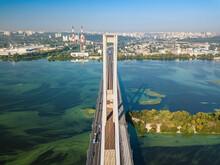 South Bridge In Kiev. Algae Bloom In The Water Of The Dnieper River. Aerial Drone View.