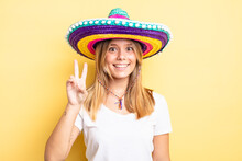 Pretty Blonde Girl Smiling And Looking Friendly, Showing Number Two. Mexican Hat Concept