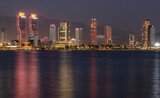 Izmir, Turkey - September 21, 2021: Night view from the sea of the new skyscrapers district of Izmir city. Izmir is Turkey's third largest city.