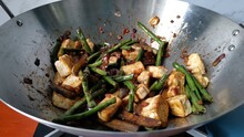 Stir Fry String Beans And Eggplant In Oyster Sauce In A Wok