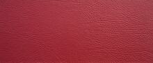 Red Rectangular Texture Of Genuine Leather. Leather Background In The Form Of A Banner. A Clean Place For Text.