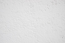 Background Of White Rough Plaster House Wall In Vintage Stile