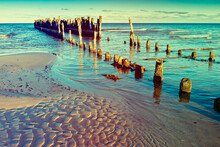Seascape With Broken Abandoned Pier In The Baltic Sea, Image Slightly Toned For Inspiration Of Retro Style