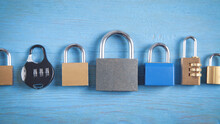 Different Padlocks On The Blue Background.