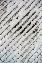 Wire Fence With Snow In Winter In Vertical On A Cold Day
