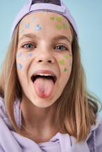 Joking European Little Girl Sticking Out Tongue