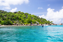 Seychelles, Motor Boat Against The Tropical Backdrop Of The Rocky Island.