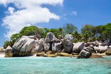 Coastal Smooth Boulders On The Large Background Of Island.