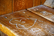 Wood Engraving Of A Love Heart On A Wooden Bench