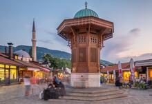 Bascarsija Square With Sebilj Wooden Fountain In Old Town Sarajevo In BiH