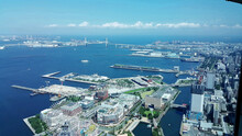High Angle View Of The Seaport Of Yokohama City At Day Time. Landscape View Of  The Bay Area On Sunny Day. Business Zone View For The Top.