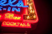 Neon Bar Sign Glowing At Night