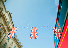 British Flags Hanging Against Clear Sky
