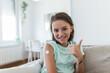 Leinwandbild Motiv Adhesive bandage on arm after injection vaccine or medicine,ADHESIVE BANDAGES PLASTER - Medical Equipment,Soft focus Adhesive bandage on a female brachium after covid-19 vaccination