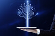 Leinwandbild Motiv Close up of hand holding tablet with abstract digital circuit tree on blurry blue background. Information, technology and business concept.