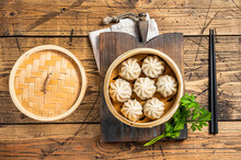 Momo Dumplings In A Bamboo Steamer. Wooden Background. Top View
