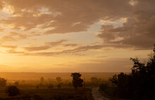 Rain Pours Down On The Village. Landscape At Sunset. Tragic Gloomy Sky. Panorama.