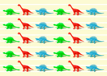 Pattern Of Green, Red And Blue Plastic Dinosaur Figurines Flat Laid Against Yellow Background