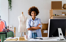Young Female Entrepreneur Standing With Arms Crossed At Studio